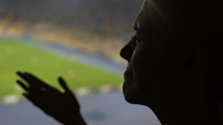resentment : Portrait of emotional lady cheering while watching sports match on stadium
