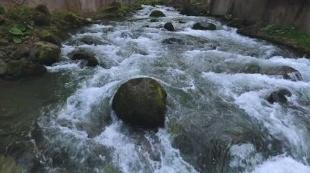 culpa : Fast rocky river flowing in Caucasian mountains in Kutaisi, travel to Georgia