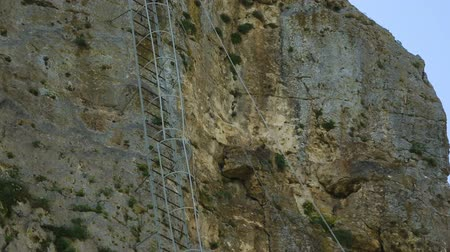 monolith : Iron ladder on Katskhi Pillar with ancient church on top in Chiatura, Georgia Stock Footage