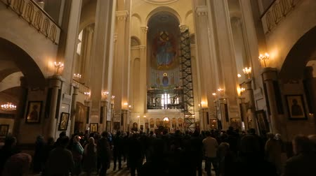 liturgy : Interior of Holy Trinity Cathedral in Tbilisi, people on liturgy, church rituals Stock Footage