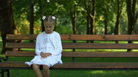 coming home : Sad girl lonely sitting on bench waiting for future parents coming, orphan