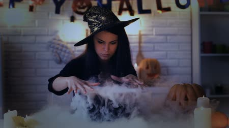 hallows : Beautiful witch performing mysterious magic ritual, cooking potion in cauldron