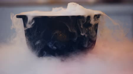 hallows : Magical potion bubbling in witch cauldron with white smoke, Halloween witchcraft
