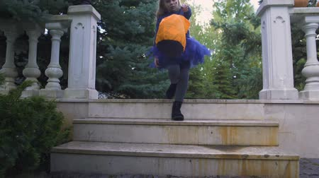 finomságok : Cute girl walking with Trick or Treat bag going to neighbor for candies, holiday