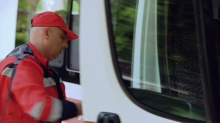 call out : Ambulance crew leaving transport, paramedics walking to patient. Stock Footage