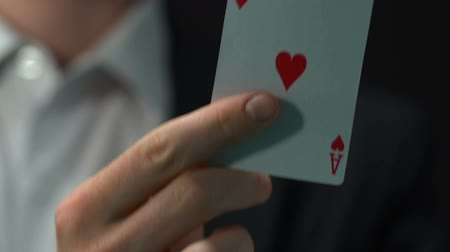 cheat : Male showing ace of hearts, chance of win and fortune, gambling and casino Stock Footage