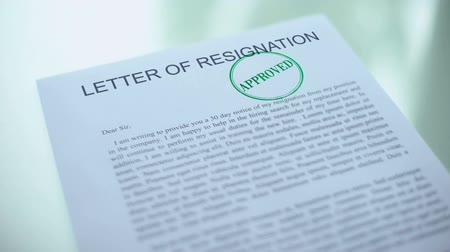 licenziamento : Approved letter of resignation, hand stamping seal on official paper, drawdown Filmati Stock