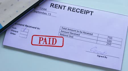 nyugta : Rent receipt document paid, hand stamps seal on official paper, regular payment