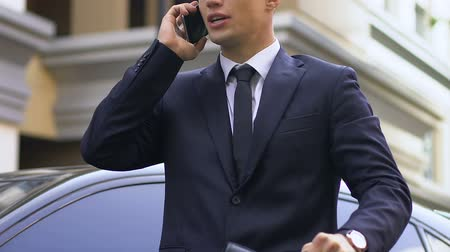 billionaire : Angry nervous business man standing on street and arguing with partner on phone Stock Footage