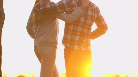 kamp : Family couple hugging and enjoying amazing sunset near campground, happiness Stok Video