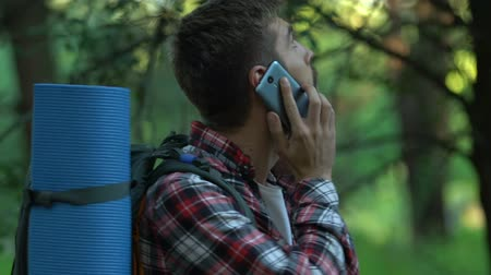 nervous : Nervous male backpacker calling 911, hiker lost in forest, bad mobile connection
