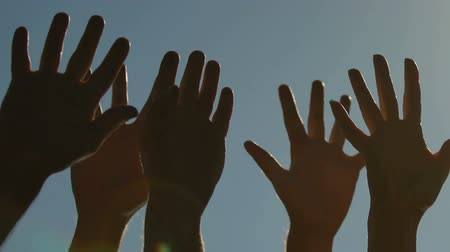 参加する : Different people raising hands to sky, voting or greeting. Concept of unity 動画素材