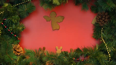 stopmotion : Angel, bunnies and heart shape cookies moving on festive background, christmas
