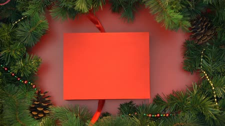 stopmotion : Red ribbon wrapping around box with striped candy canes and tying in bow, x-mas Stock Footage