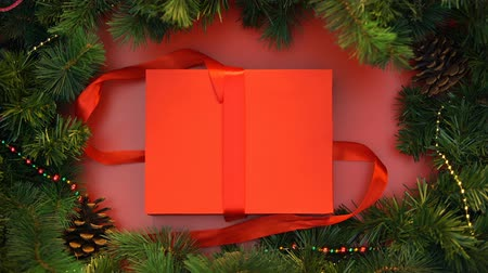 stopmotion : Christmas gift with candy canes unboxing, top view stop motion effect.