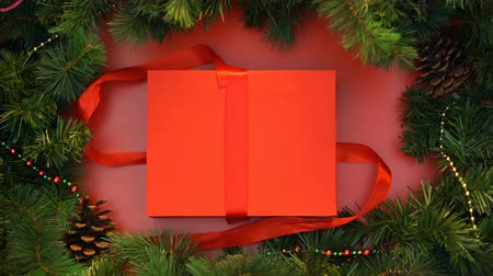 stopmotion : Unpacking of giftbox, wrapping tips, preparing for xmas and new year, top view Stock Footage