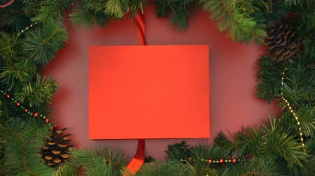 stopmotion : Gift box with fresh gingerbread cookies wrapping with red ribbon. Stock Footage