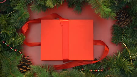 stopmotion : Red ribbon untying and gift box with wooden christmas toys opening Stock Footage