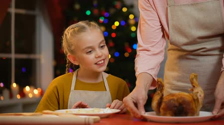 пенсионер : Little girl helping her granny to serve Christmas table, decorations sparkling Стоковые видеозаписи