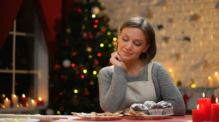 miraculous : Young lady sitting at table with chocolate muffins, Christmas preparations