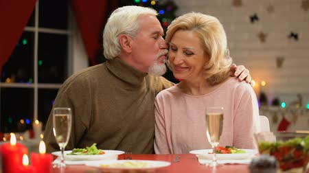 lasting : Sweet aging man and woman celebrating Christmas together, romantic evening
