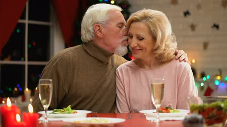 lasting : Retiree couple having nice time at home together on Christmas eve.
