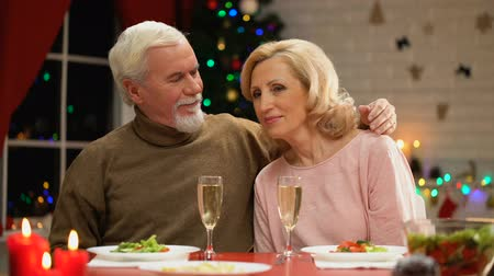 lasting : Aging male tenderly hugging wife, celebrating Christmas eve together, romance Stock Footage