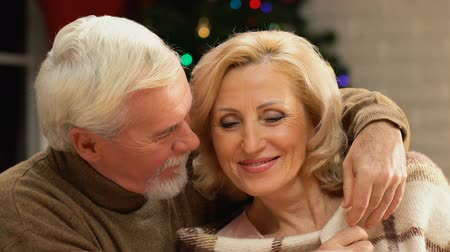 amado : Old man gently wrapping woman with blanket, caring for beloved wife, closeup Stock Footage