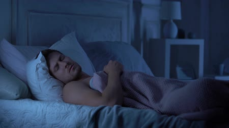 traumatic : Young male sleeping unwell, suffering nightmare talking in sleep, troubles