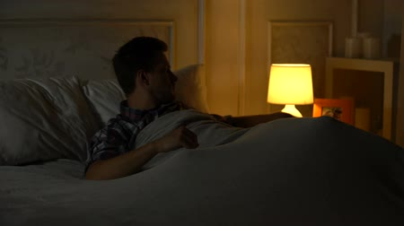 colchão : Male having insomnia, switching on light, missing wife, family problems, divorce Stock Footage