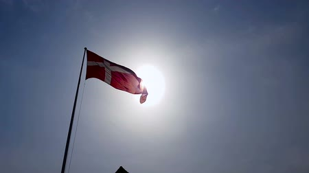 glória : Denmark flag waving in sky under sunrays, national symbol, patriotism emblem