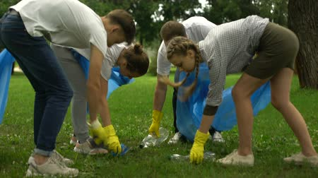 sobota : Family of enthusiasts doing voluntary Saturday work, picking garbage in park