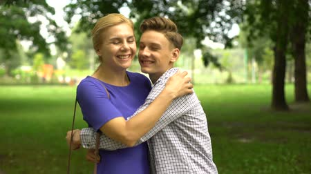 trusting : Teenage son kissing his beloved mother, friendly relationships, understanding Stock Footage