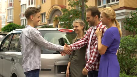 prawo jazdy : Parents gifting keys from new auto to loving teenage son, perfect present for bd