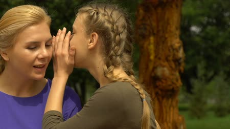 whispering : Teen girl sharing secret, whispering to mother, first kiss revelation, trust Stock Footage