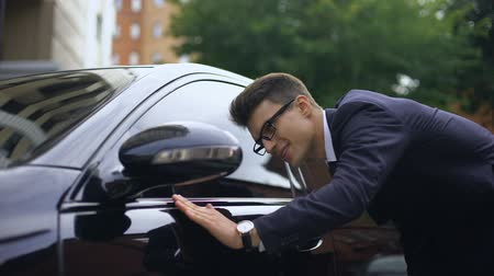 седан : Delighted man in suit stroking car and getting in, earning money for purchase