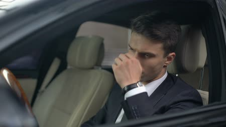 dinlenmek : Business man with eyesight problems taking off glasses in car, stressful job Stok Video