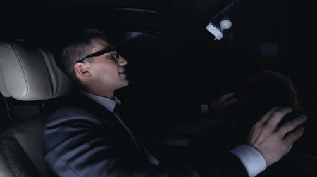 falido : Angry businessman furiously hitting steering wheel in car at nighttime, problems Stock Footage