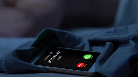 zdrada : Missed call from boyfriend, man sleeping on blurred background, gay betrayal