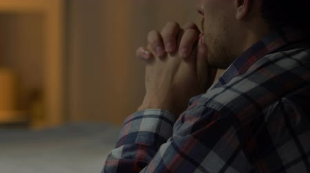 santo : Sad man standing on knees and praying to God, problems in life, faith and hope Stock Footage