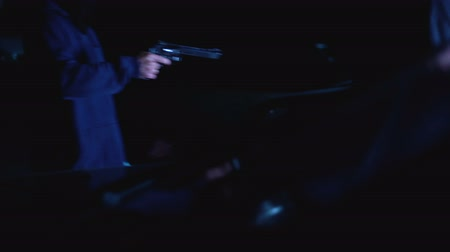 mafia : Teen robbing businessman at car park, threaten with gun, nighttime attack Stock Footage