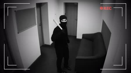 evidência : Man in black mask braking CCTV camera with baseball bet, evidence destruction
