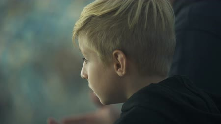 resent : Boy emotionally watching sport game at stadium, shouting in support, closeup