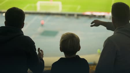 penas : Boy with family nervous about football match, disappointed with missed goal Stock Footage