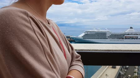 social inequality : Girl in worn clothes looking at expensive ship, gap between rich and poor