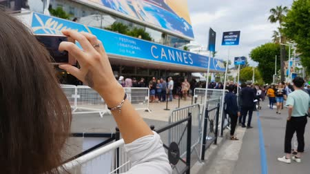 queue : Woman taking picture of her favorite producer on international cinema festival