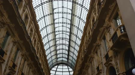 milan fashion : Galleria Vittorio Emanuele II, panoramic glass roof in shopping mall, landmark Stock Footage