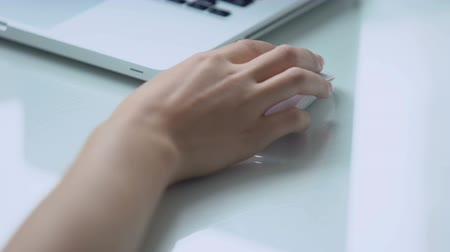 vstup : Hand using wireless mouse with laptop, personal computer use for office work