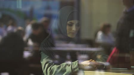 direitos : Sad Muslim female in cafe, suffering loneliness, divorce, emigration problems
