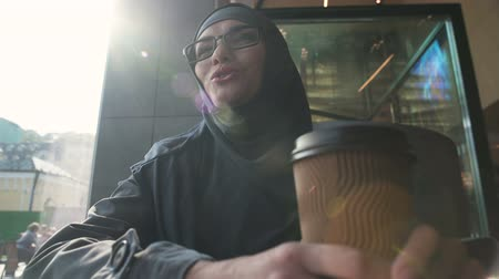 self motivated : Attractive self-confident Muslim lady communicating with friends in cafe. Stock Footage